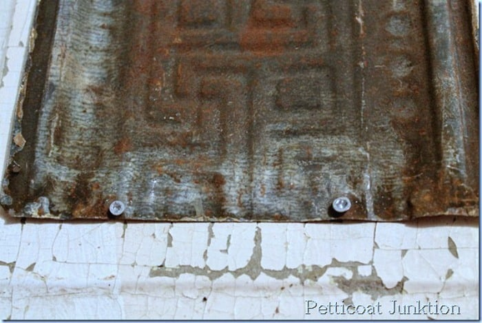 attaching rusty tin to board using screws Petticoat Junktion magnet board
