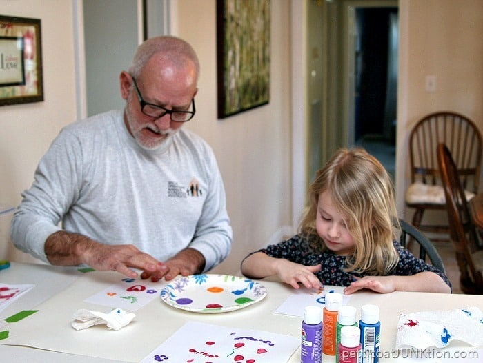 Papaw and granddaughter finger painting together Petticoat Junktion Family Craft Time