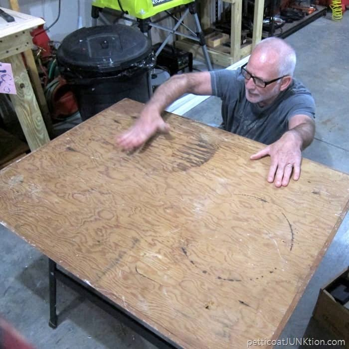 working on a table project in the workshop