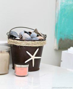 sisal rope wrapped rusty seashell bucket