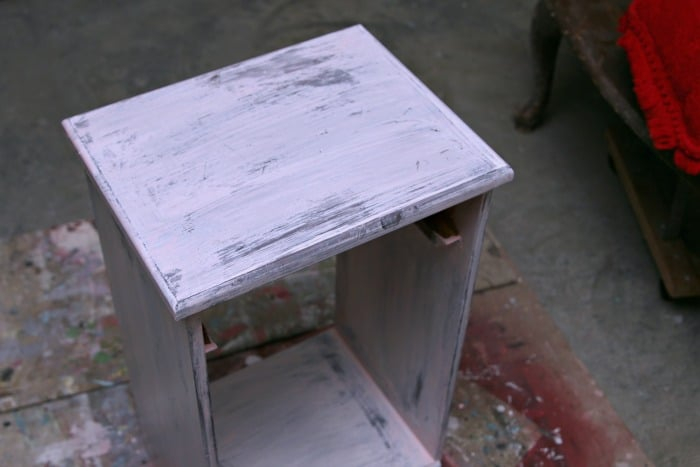furniture makeover project with paint layers