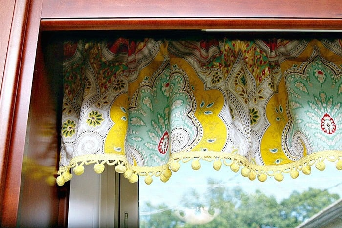 curtains with cheery yellow pom pom fringe
