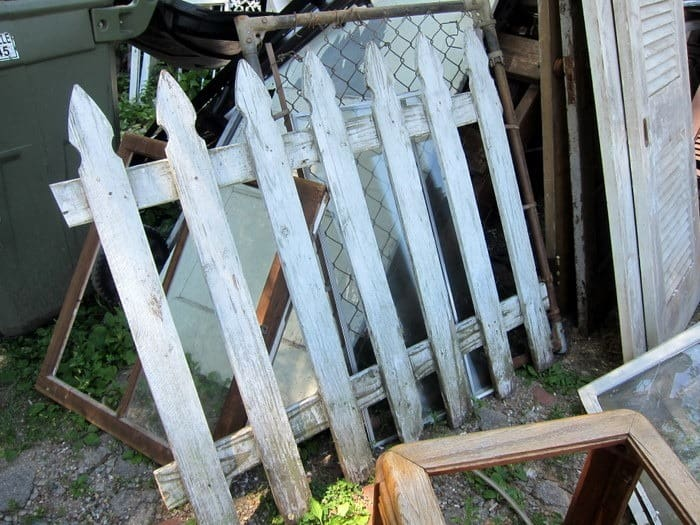 chippy white picket fence panel