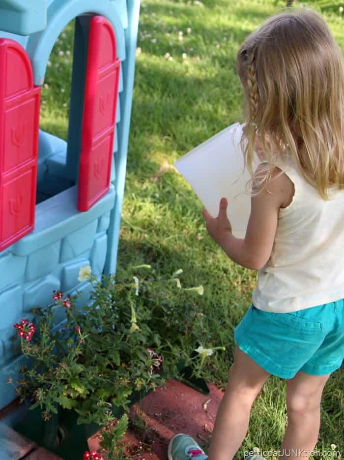 Sofi watering flowers