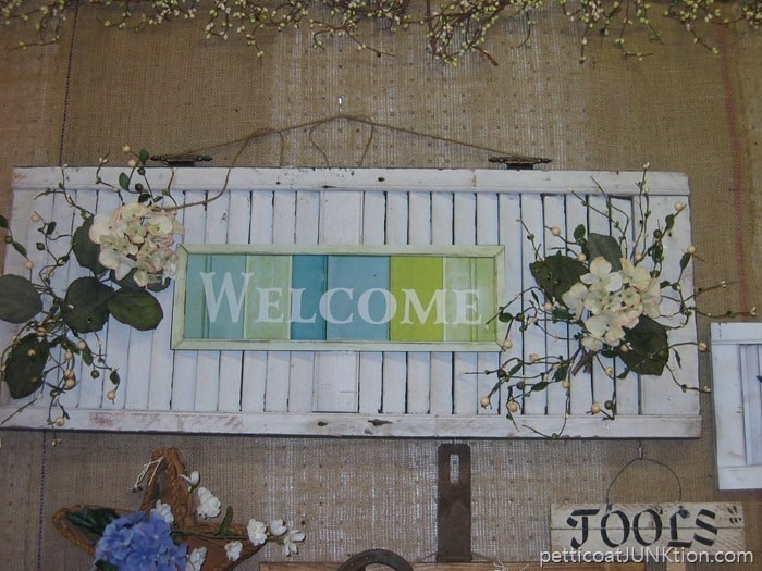 blue and white shutter sign Petticoat Junktion