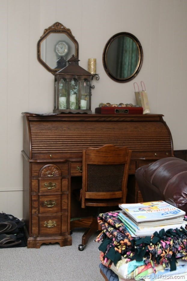 cluttered desk and cedar chest