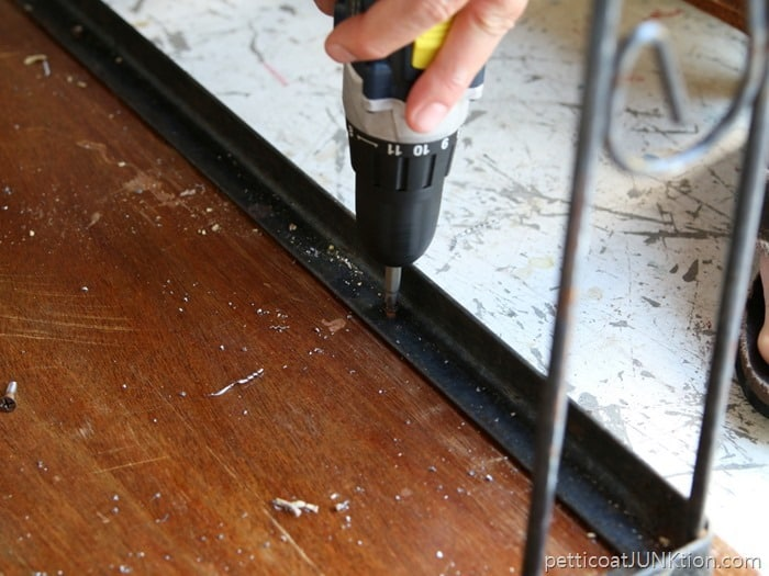 attaching table top to metal stand