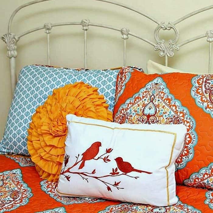 decorative bedding and bird pillow