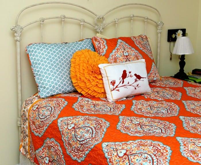 decorative bedding in turquoise and orange