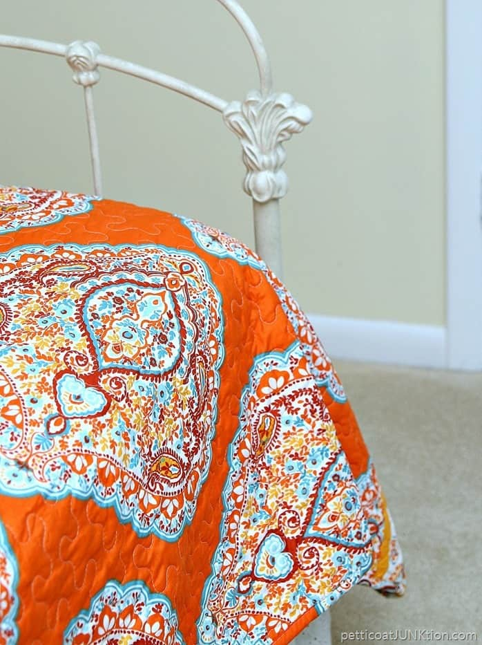 pretty turquoise and orange paisley print bedding