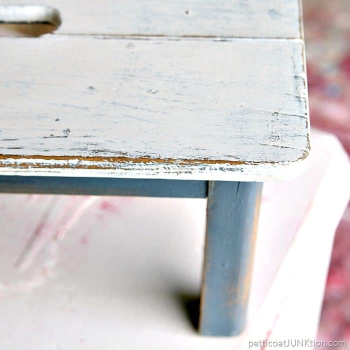 small milking stool painted gray and white