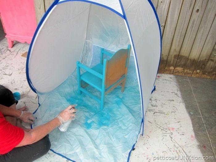 spray painting in a HomeRight spray shelter