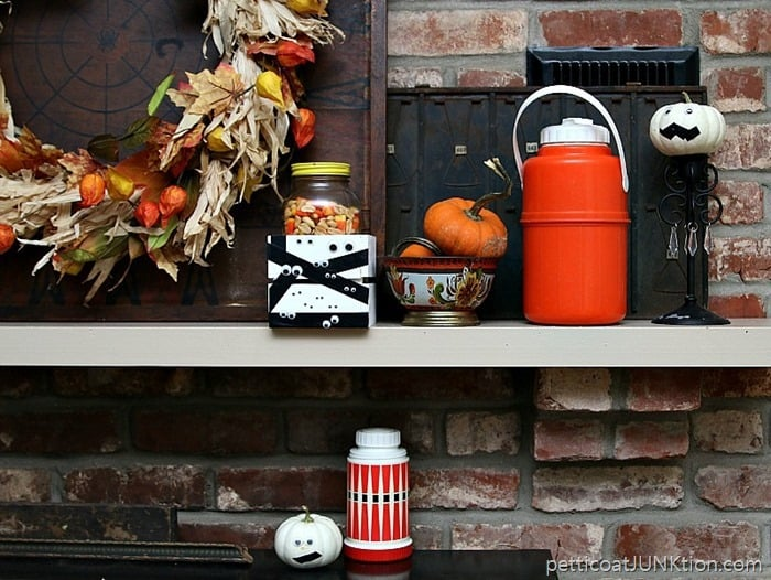 Fall mantel decorations featuring vintage finds and white pumpkins