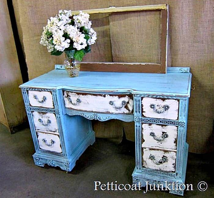 heavily distressed blue and white desk