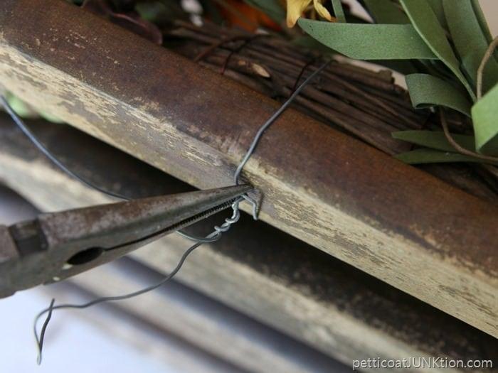 twist wire to hold wreath