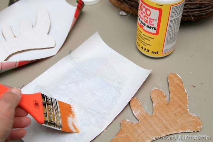 Mod Podge to adhere decorative plaid paper for horns