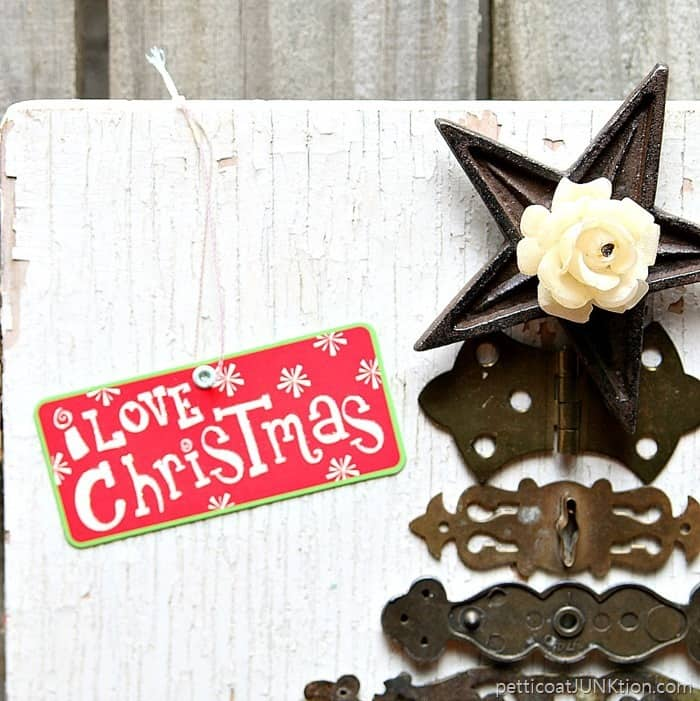 Star tree topper and reclaimed hardware branches