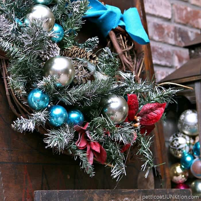 Christmas wreath in turquoise and red mantel decorations