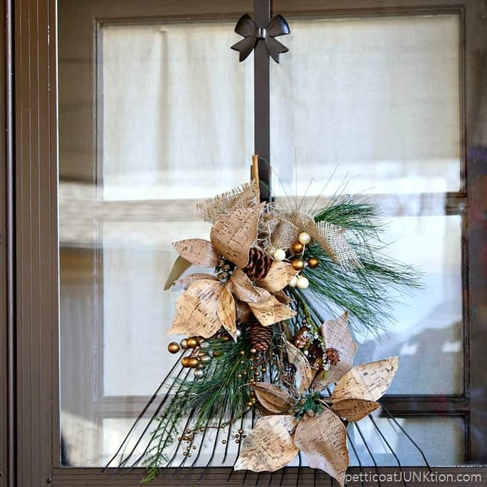 Rake Wreath made with poinsettias and pine cones