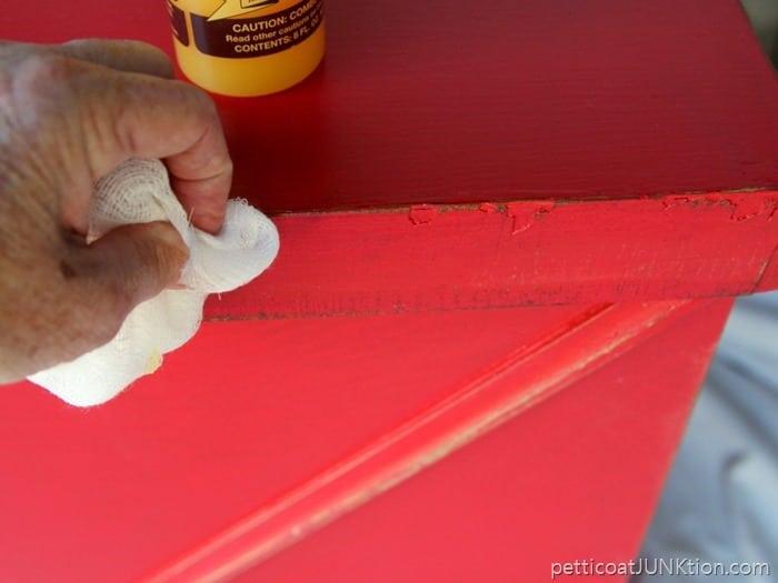 applying Howard's Feed n Wax to darken distressed areas