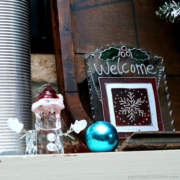 snowman ornament and welcome sign