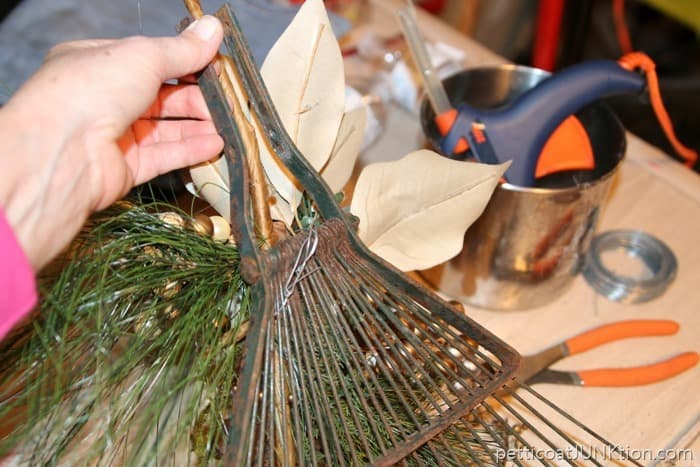 wire greenery sprig to the rake