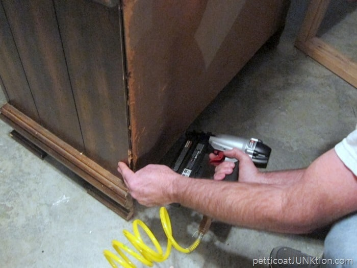 using a nail gun to reattach the furniture back