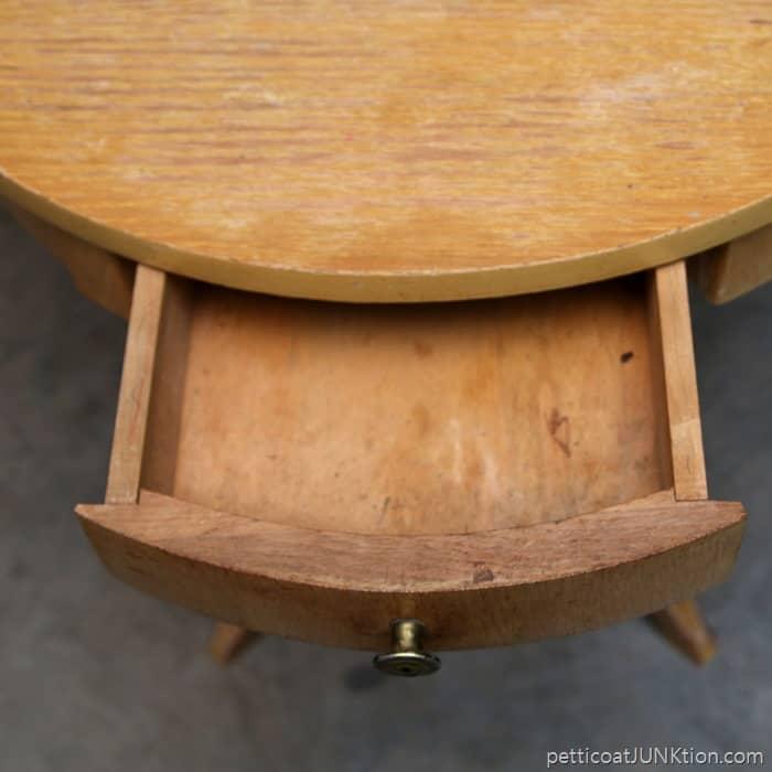 Unique vintage blonde drum table