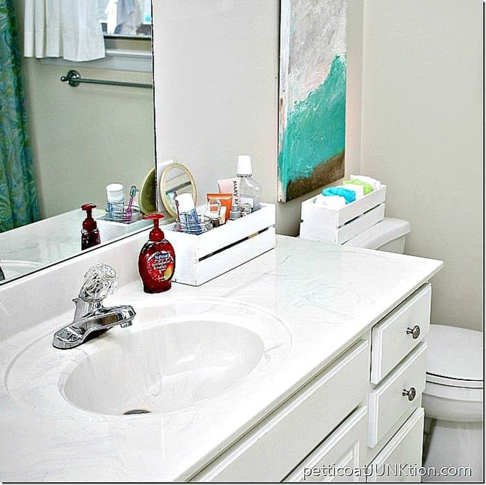 white bathroom with wood crates for organization