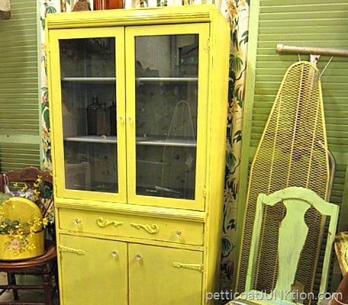 yellow cabinet painted with gray primer on the interior