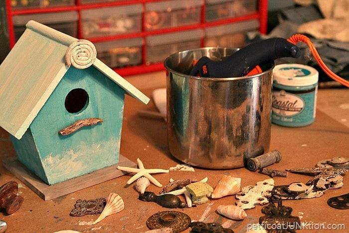 adding finishing touhes to the birdhouse