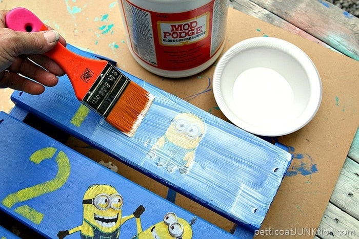 brush on two or three layers of Gloss Mod Podge to protect decoupage project