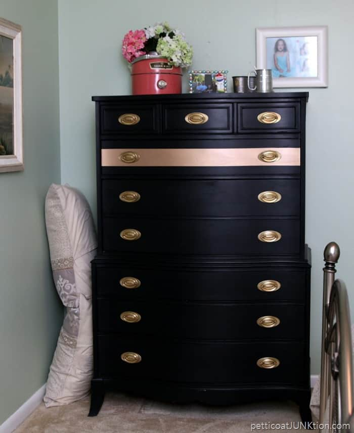moved the gold and black chest into the bedroom