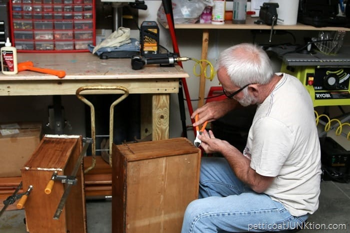 using wood glue and clamps to repair furniture drawers