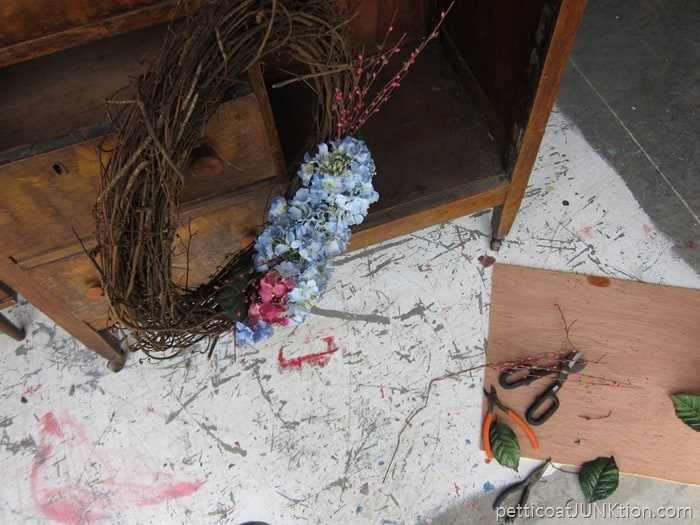 hanging the wreath during the makeover process helps with getting the details right