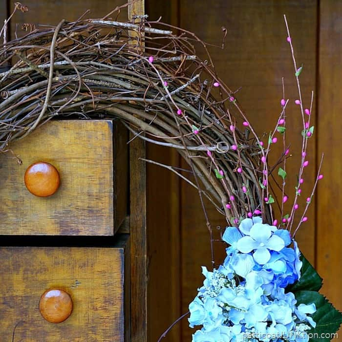 hydrangea grapevine wreath with pink accents