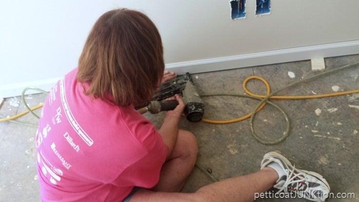 installing floor molding in Habitat for Humanity home Nashvillle Women Build 2017