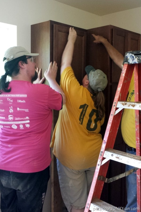 installing kitchen cabinets in Habitat for Humanity home