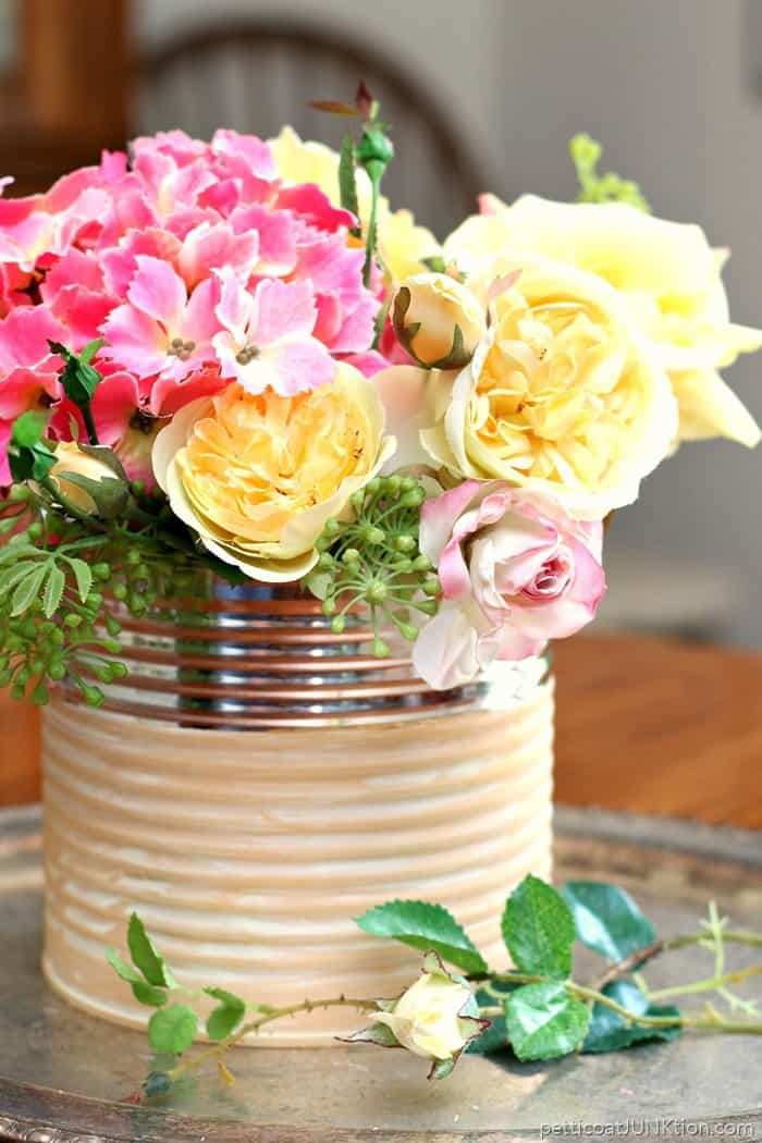 recycle a coffee can and make a pretty flower vase using paint and white wax