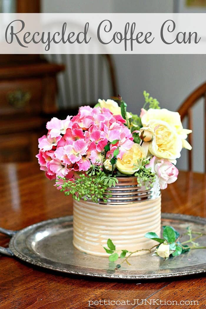 recycled painted and waxed coffee can makes a beautiful flower vase