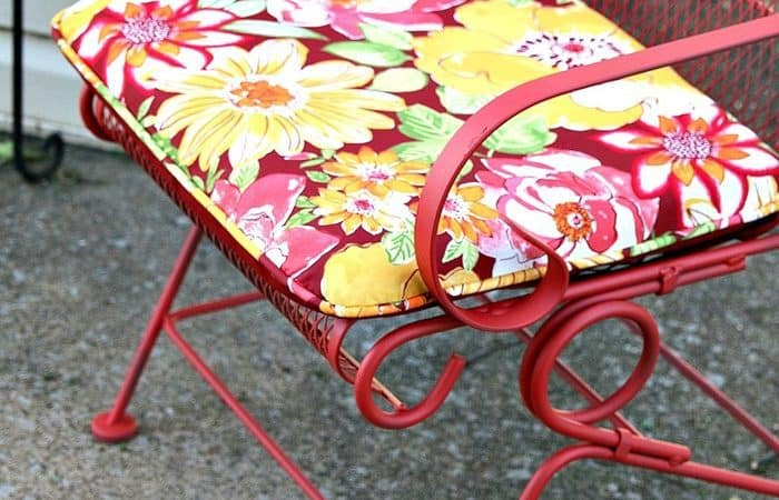 pretty floral outdoor cushions and scarlet spray paint