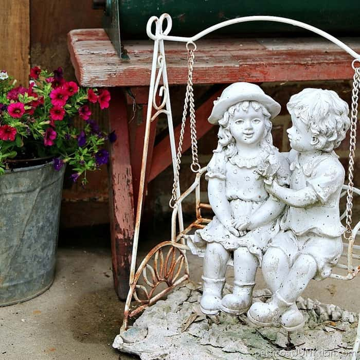 boy and girl garden statues