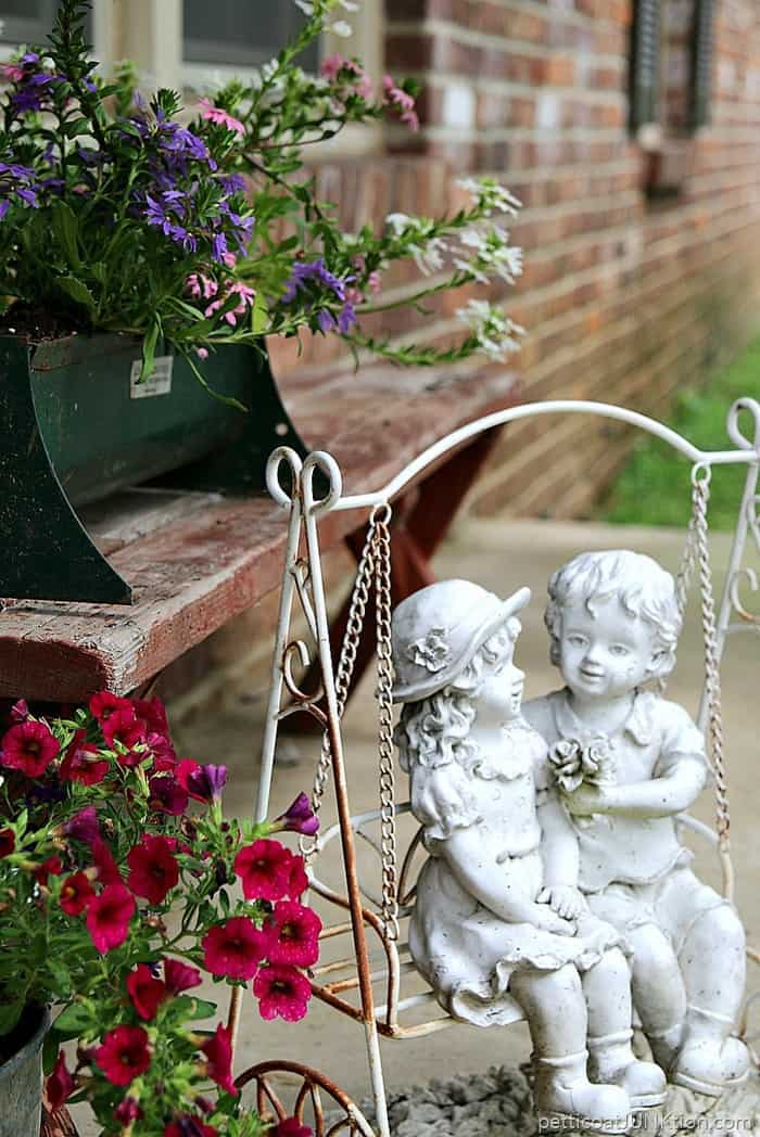 fancy flowers in rusty containers for porch decorating