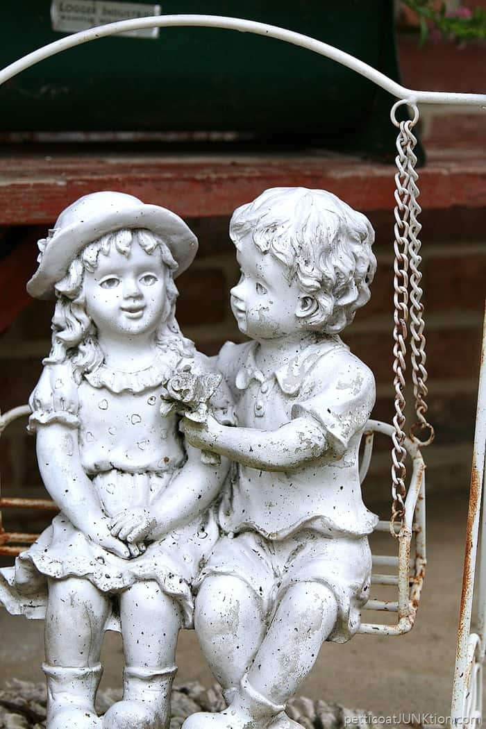 girl and boy garden statues