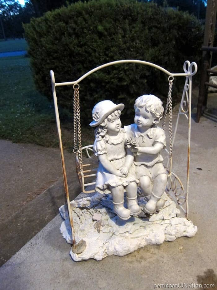 girl and boy plaster statues