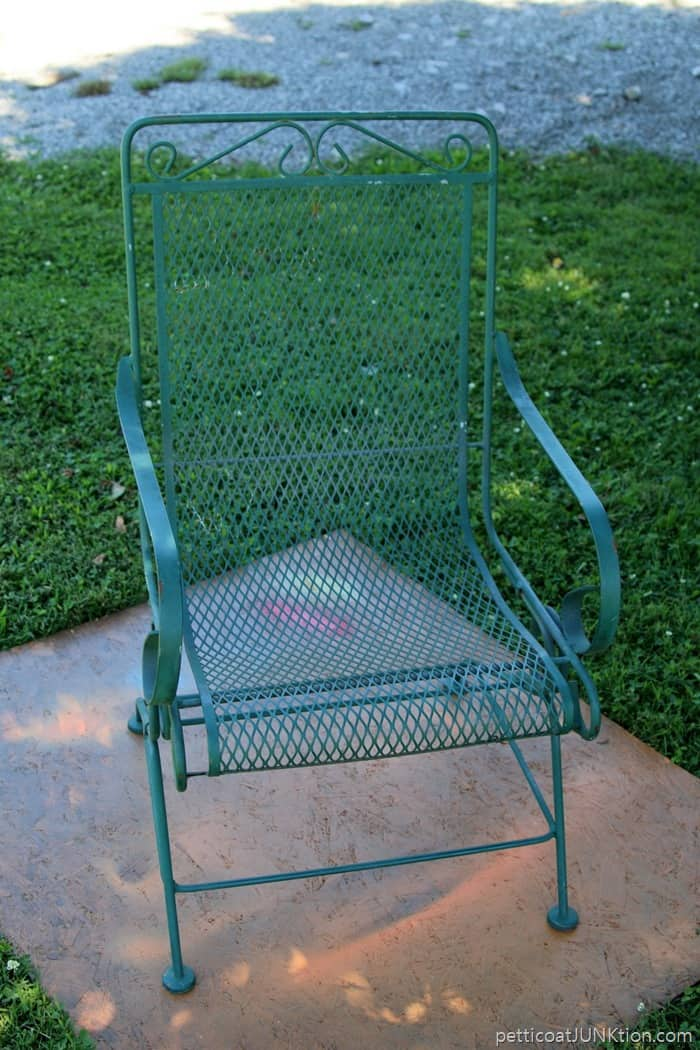 green wrought iron chair before spray paint makeover