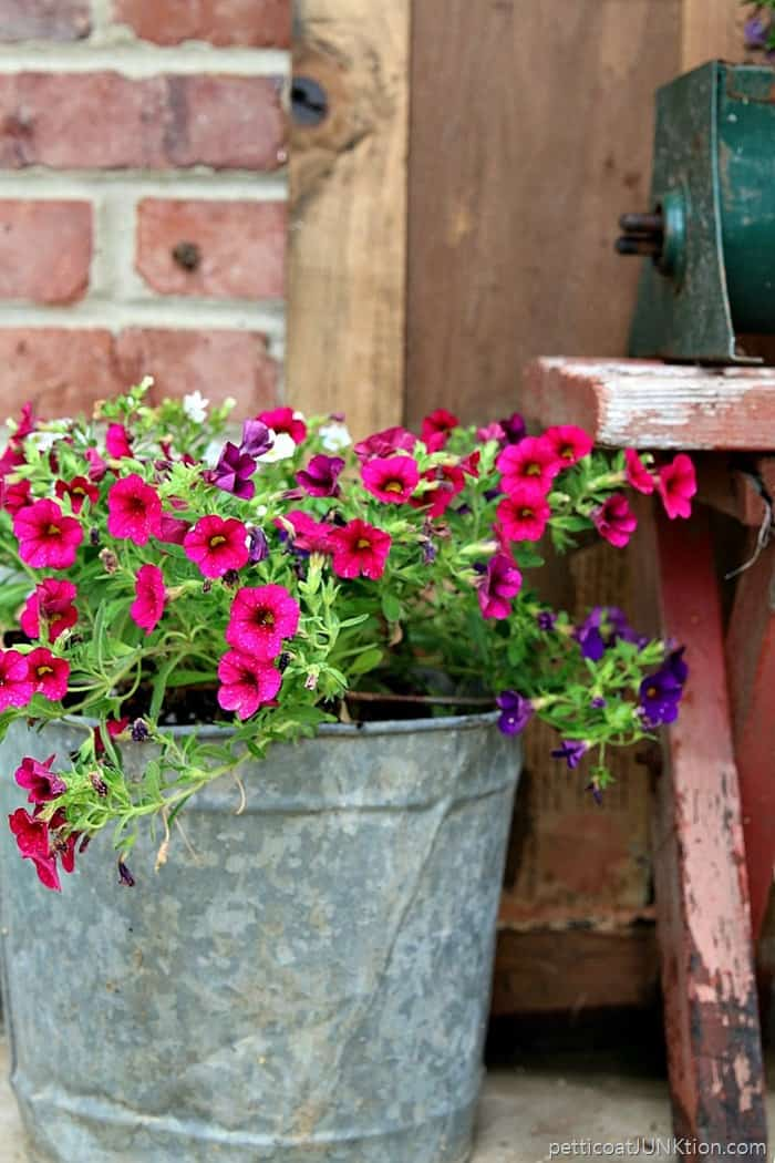 junk bucket flower planter