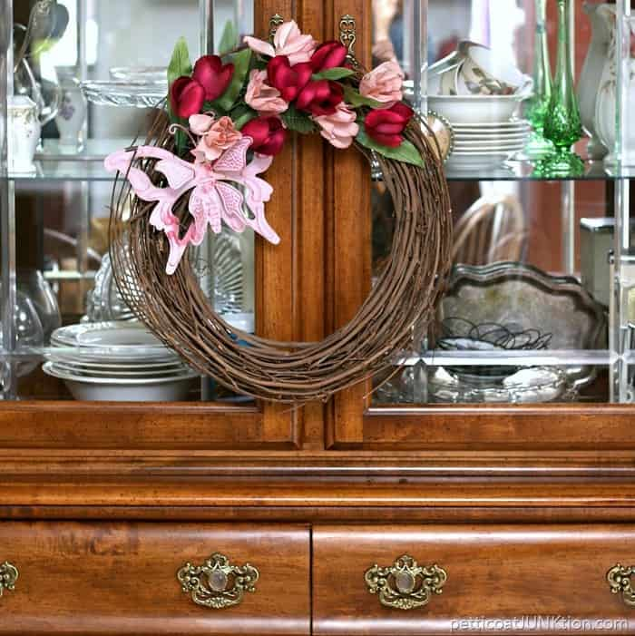 pink butterfly wreath is made from thrifty finds