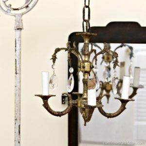 Junk Chandelier Swings From Antique Lamp Stand