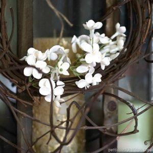 simple wreath with white flowers and grapevine